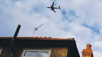 Plane over house